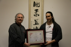 Sifu Allan Graham presenting Brendan with his Second Level (Grade 7) - 2012